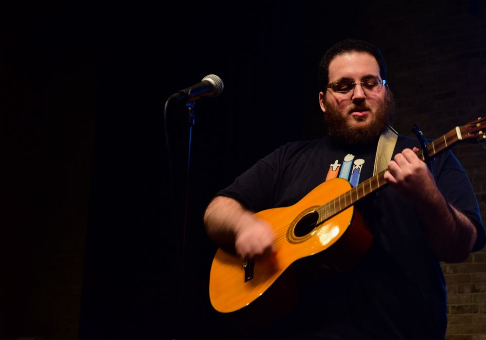 Jonas Pallaro-Sonneborn, a fourth-year creative writing student, performing at a previous coffee house.