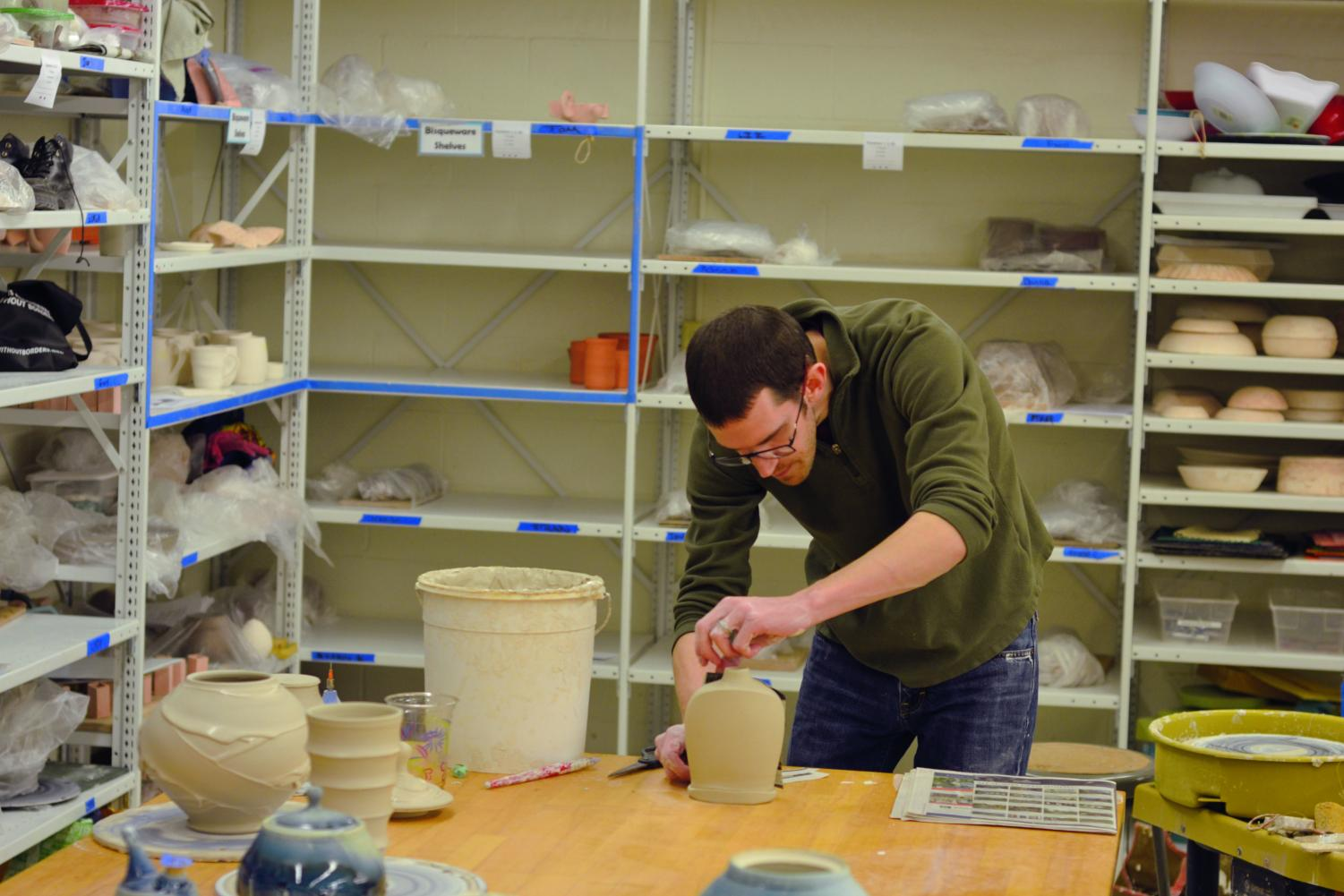 Chris Lively, a ceramics artist, works on his pottery.