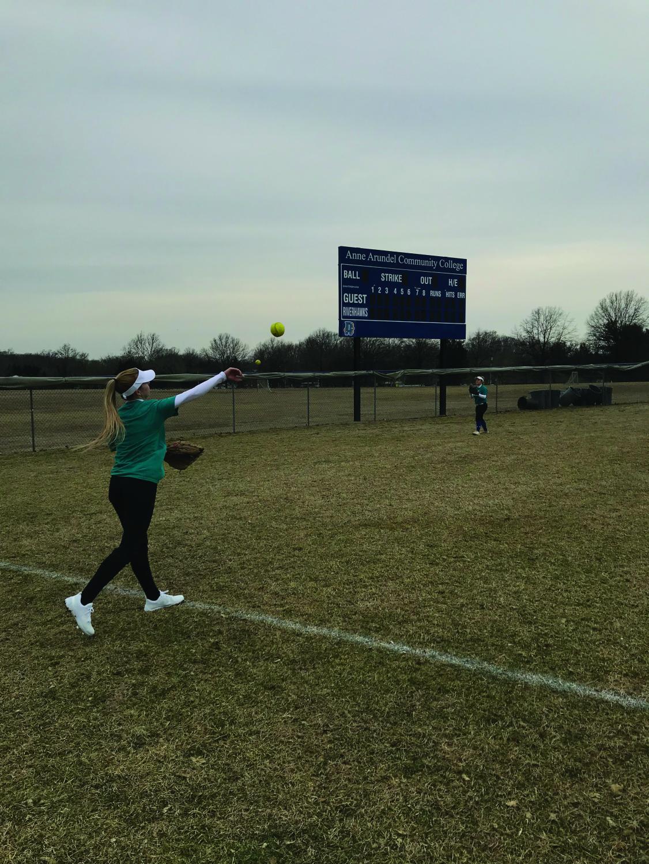 Softball player Sylvia Frye throws to her teammates.