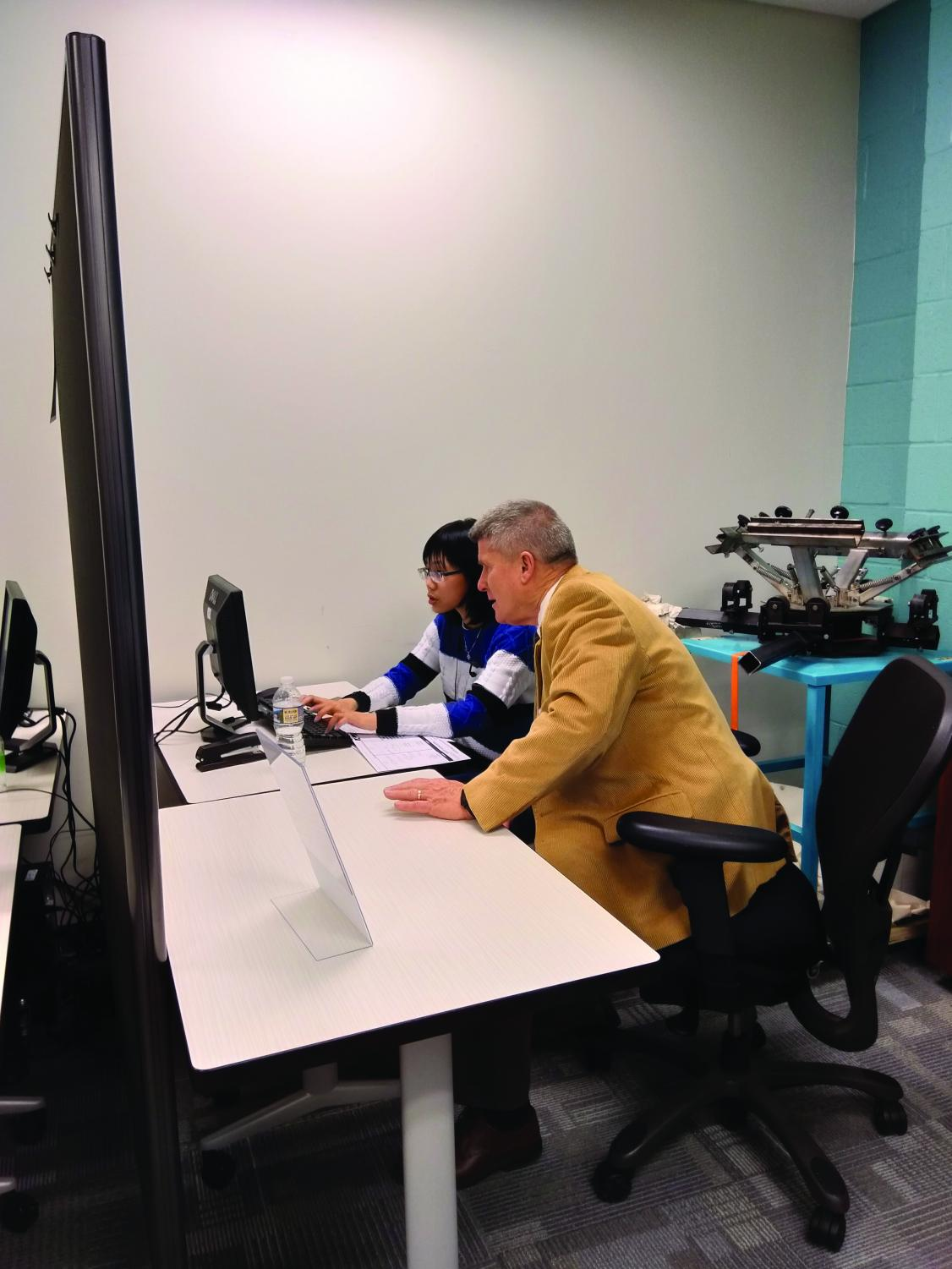 Accounting professor Mike Gavin and 26 volunteers are helping students and staff with their taxes.