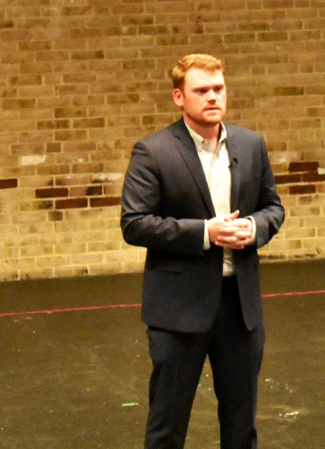 Business banker Andrew Carlson speaks at an annual Business Pitch Competition.