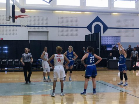 Lacey Hinkle, forward for the Riverhawks, shoots and scores a free throw