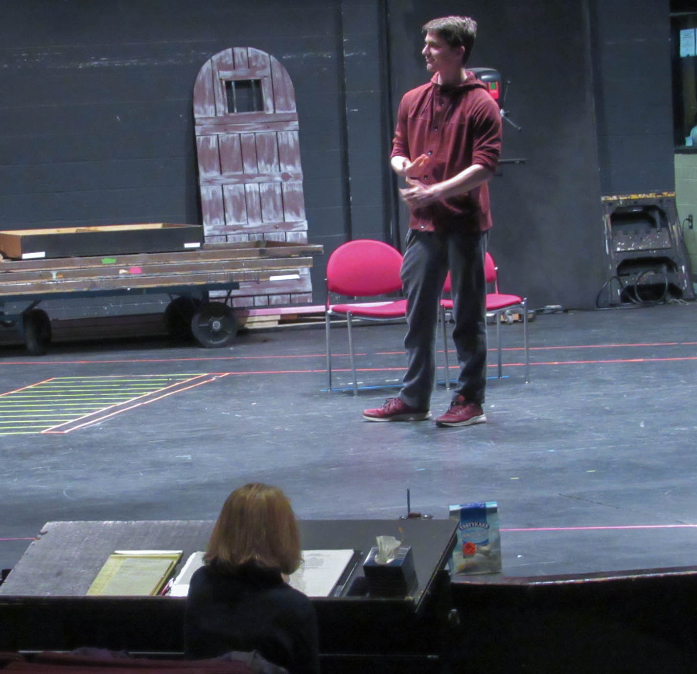 Jack Venton develops his character with direction from Dr. Saunders.