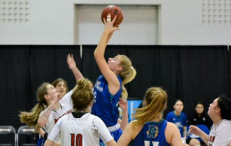 Women's Basketball center Sarah Healy takes a shot at this season's national tourna-ment.