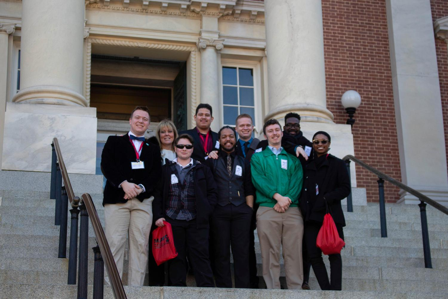 AACC President Dawn Lindsay poses with Director of Student Engagement Leon Thom-as and seven students at this year's Student Advocacy Day. At the event, students spoke to Maryland legislators.