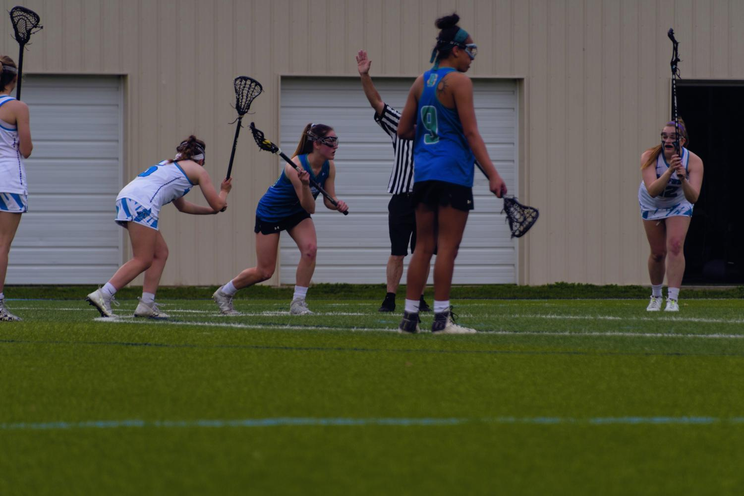AACC Women's Lacrosse players Mariah Scott and Natalie Sonntag battle against Harford Community College in their game on April 8.