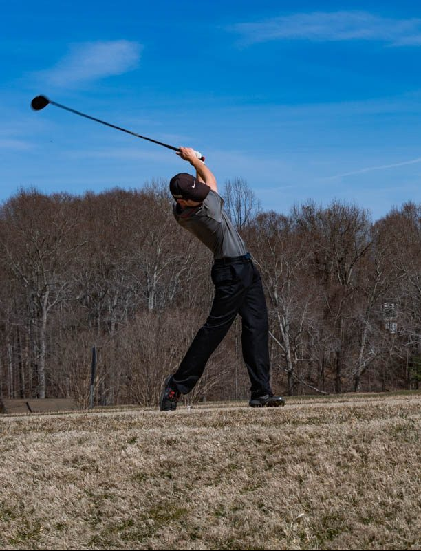 First-year golfer Alex Colonna practices with AACC Men's Golf, which former Chesa-peake High School varsity coach Kevin Lyons will lead this season. All but one player this season is new to the team.