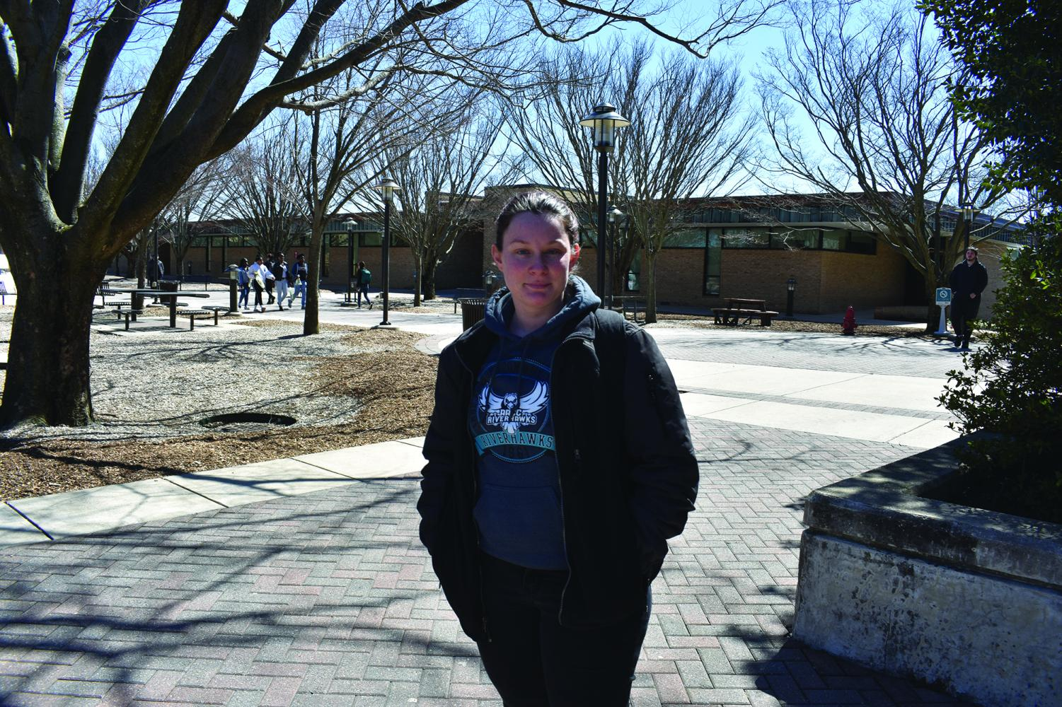 AACC Riverhawks like second-year creative writing student Rani Jenkins show their school spirit by wearing the Riverhawks logo on their clothing.