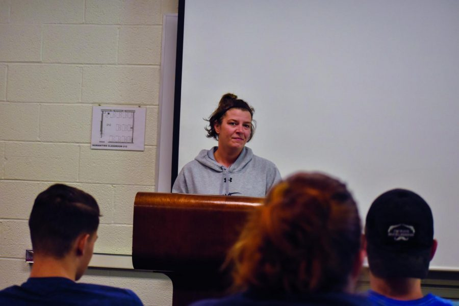 Michelle Rasmussen, a third-year health, fitness and exercise student, gives a speech to her class.
