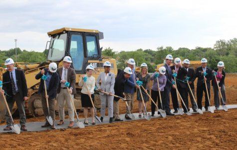 President Dawn Lindsay, County Executive Steuart Pittman and members of the college faculty, construction and Board of Trustees gathered infront of the muddy plot that will become the Health and Life Sciences building in August  2021