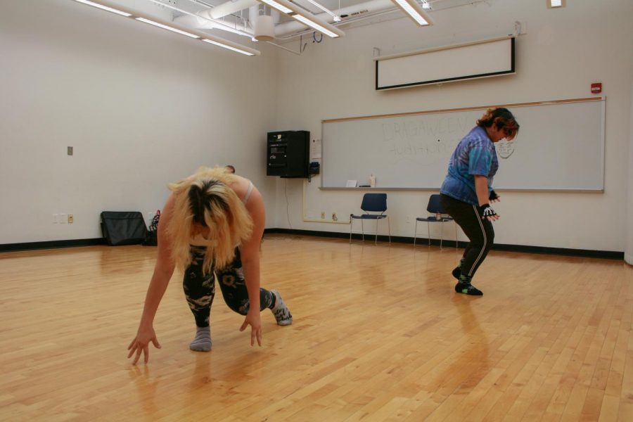 Crystal Jones (left) and Erica Romero (right) practice their routines for the upcoming performance Drag-O-Ween hosted by the Gay-Straight Alliance