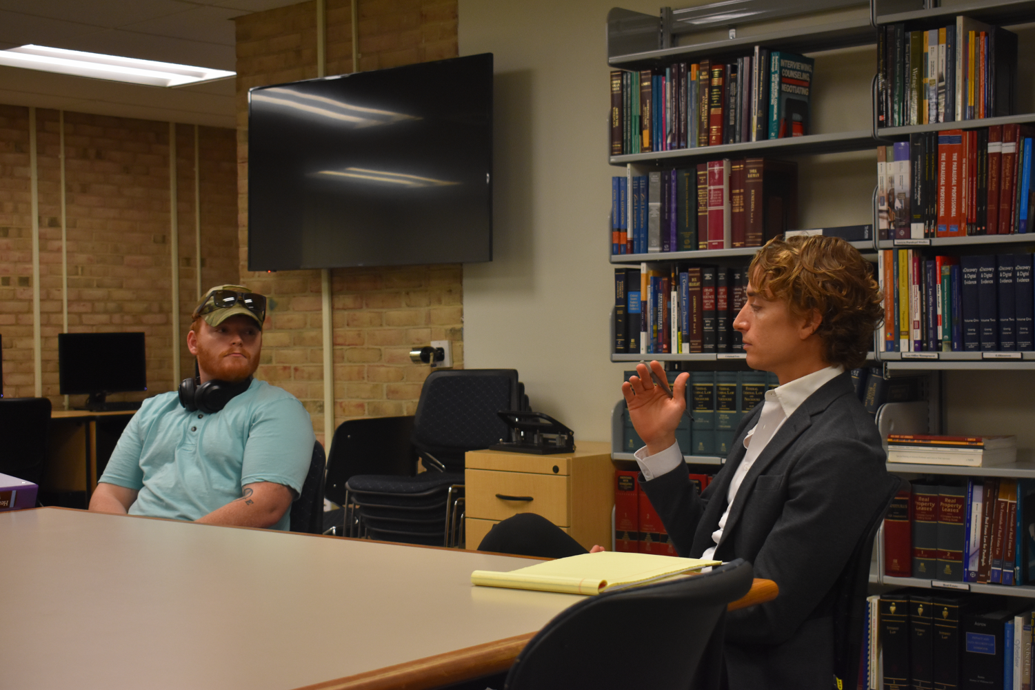 Legal Studies club held their first meeting of the semester Thursday.  Pictured: Elias Barnard (left) and Professor Luke Fredericks.