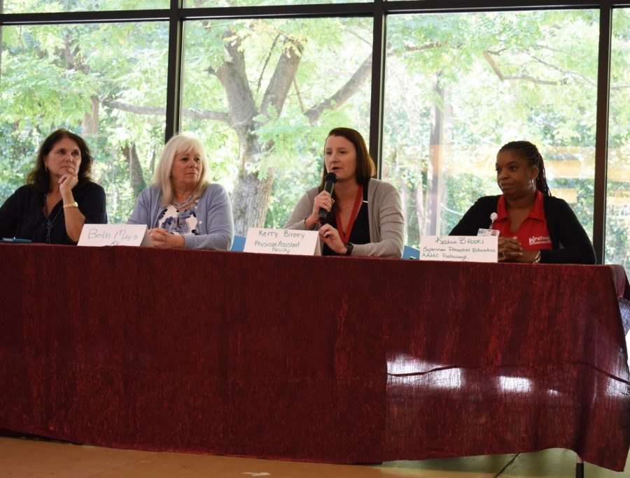 Carol Jacobson, a tobacco treatment specialist, Beth Mays, manager of the Health and Wellness Center, Kerry Birney, a physicians assistant and Keisha Brooks, supervisor prevention education AAMC Pathways talk about the use of vaping among young people at a panel discussion hosted by AACC.
