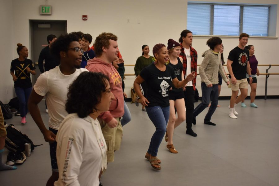 Students and faculty dance under the instruction of Haitian band members on Oct. 3.