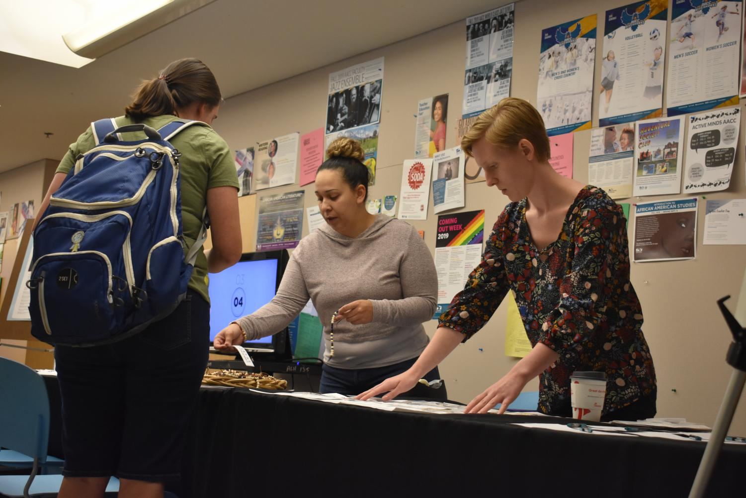 The Health & Wellness Center staff helps students deal with stress and gives out bracelets and gratitude journals. Above, Outreach Coordinator Rodaelys Rojas (left) and Peer Health Educator Madeline Piper with a student.