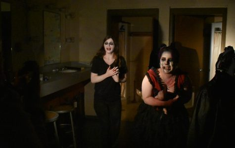 Actors try to scare students as they walk through the haunted theater.