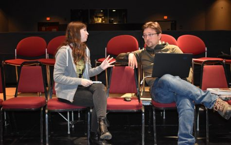 Lauryn Damron (left) and  professor Sean Urbantke help put together the performance.