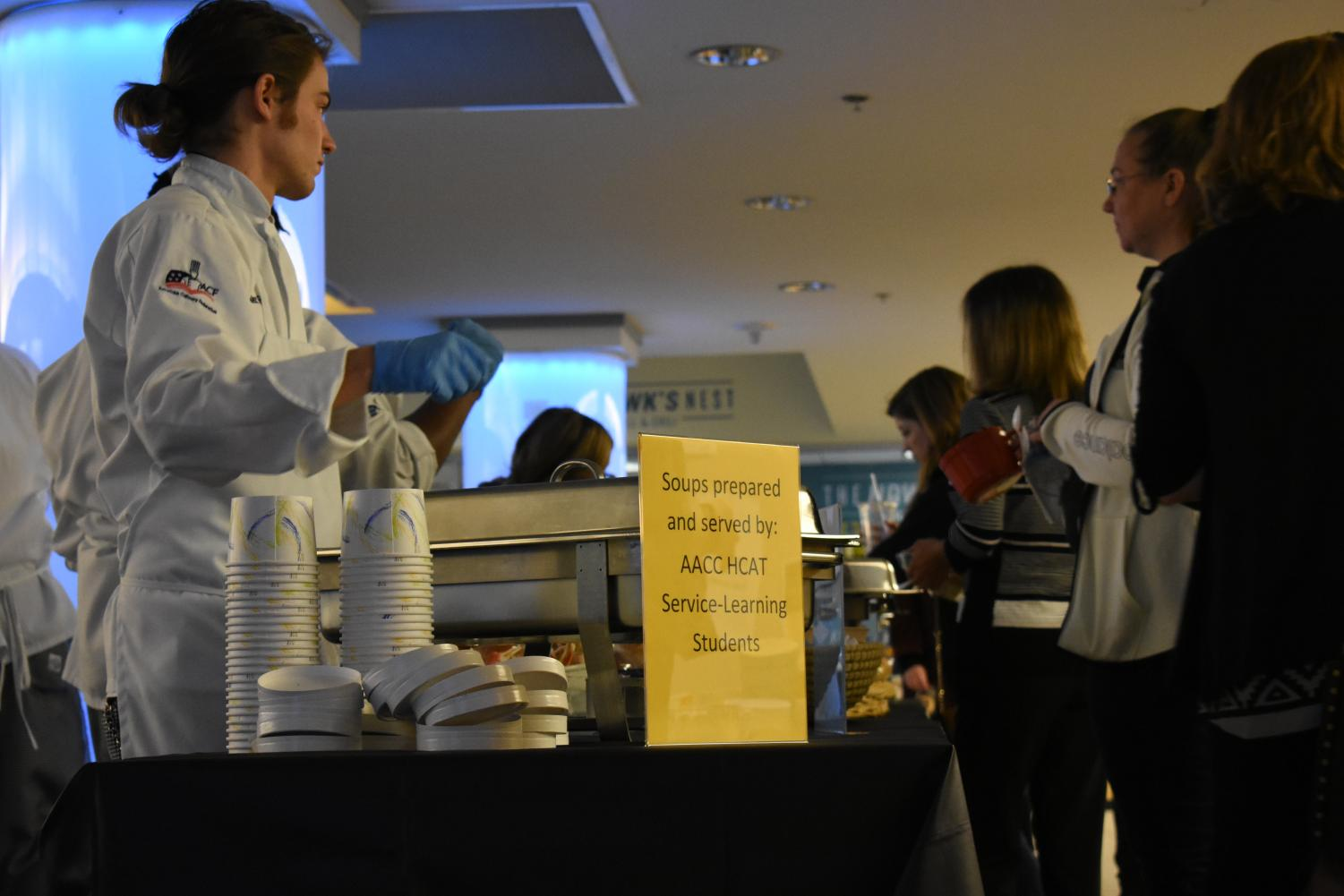 Culinary students serve soup to attendees at the Empty Bowls fundraiser