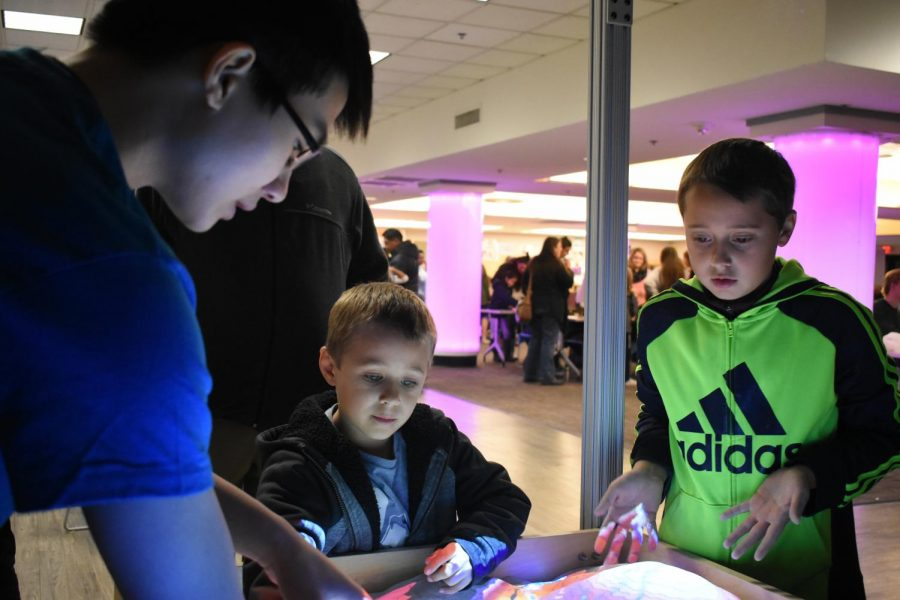 AACC students teach visiting children on Science Night