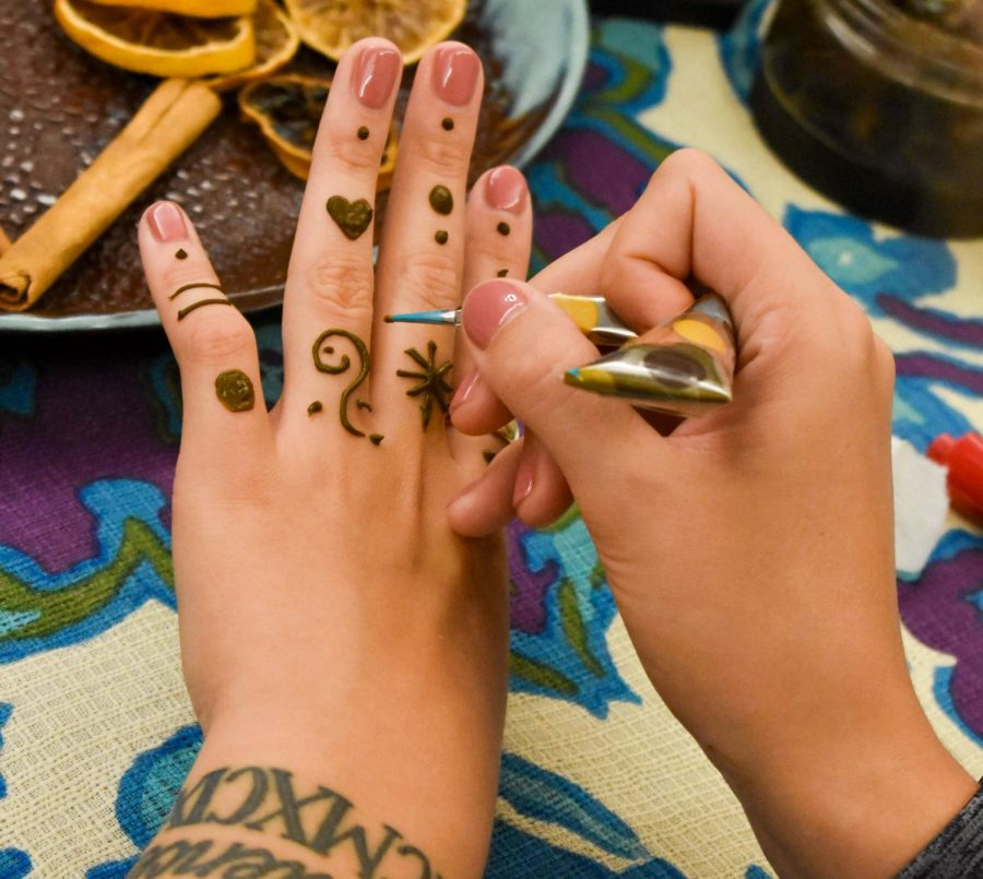 Artists use henna paste to create semi-permanent designs on their bodies.