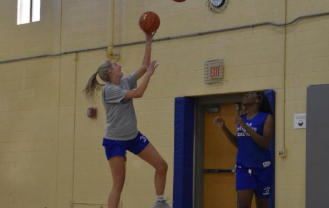 Second-year transfer studies student Sarah Healy, left, and first-year nursing student Ruth Marshall practice for the basketball season.