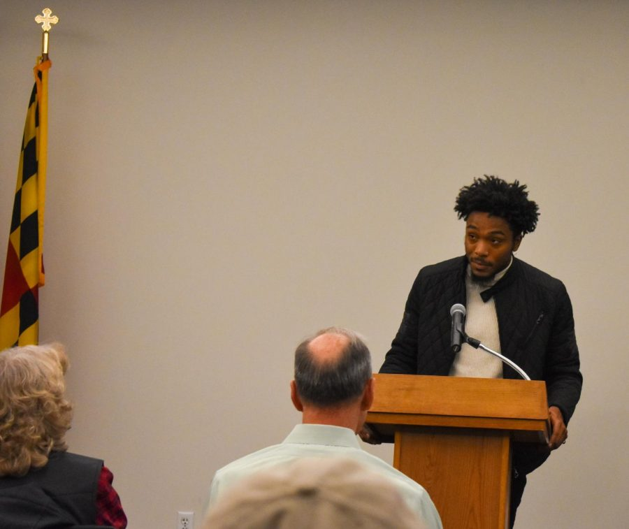 Third-year psychology student Tevin Paige speaks at a ceremony honoring veterans at AACC.