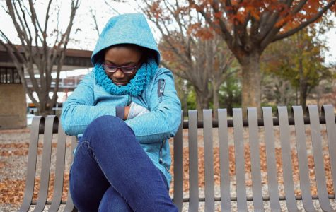 Second-year creative writing student Magdaline Thompson bundles up against the cold weather.