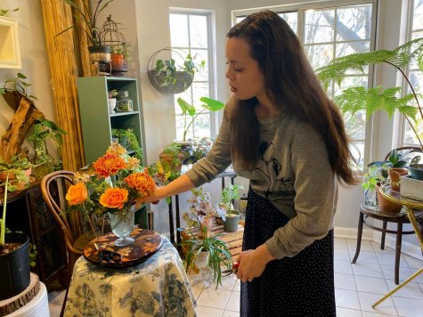 Second-year entrepreneurial studies student Sara Gray-Foreman arranges flowers for weddings.