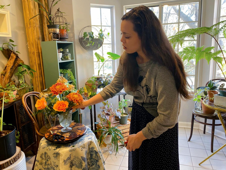 Second-year entrepreneurial studies student Sara Gray-Foreman arranges flowers for weddings.