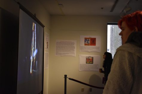 Students visit the Pascal Gallery lynching exhibit.