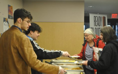 SGA members serve breakfast to students at the Meet and Greet.