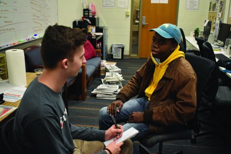 First-year communications student Jacob Hudson (left) interviews second-year journalism student and new Campus Current Editor-in-Chief Christian Richey.