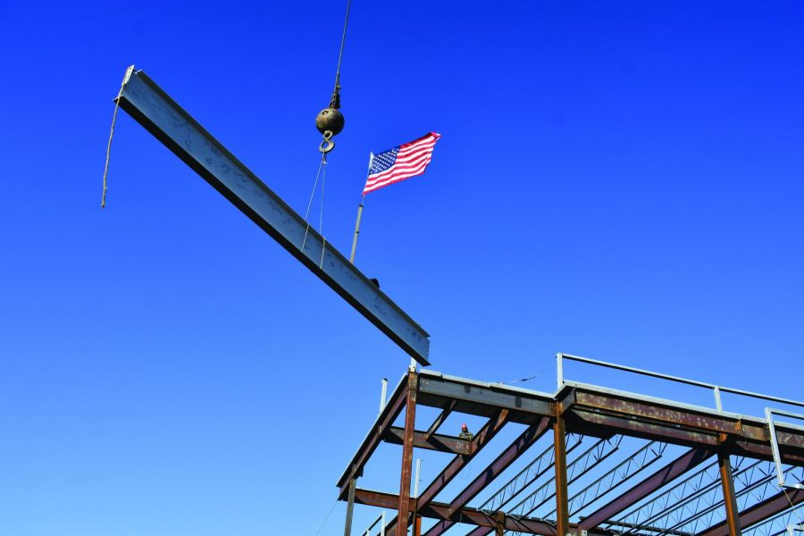 Whiting-Turner places the final piece of steel in the frame of the new Health and Life Sciences Building on campus.
