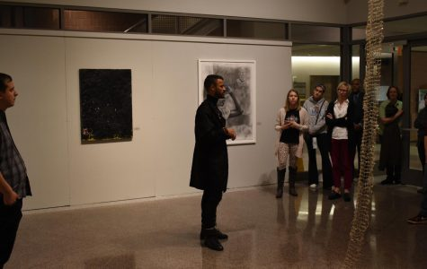 Curator Thomas James speaks to an audience of students and faculty about the art exhibit Grey Matter: A Response to Blackness, held in the Cade Gallery.