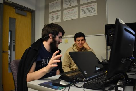 Computer Science Club members Jeremy Snyder, a second-year computer science student (left), and Vincent Aurigemma, a first-year computer science student work on a project during the club meeting.
