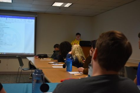 Mitchell Santos tells fellow SGA members about new events.