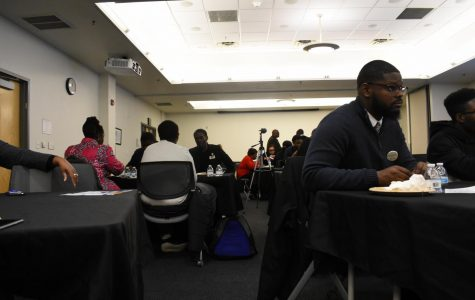 Students talk during the 10th annual Black Male Summit.