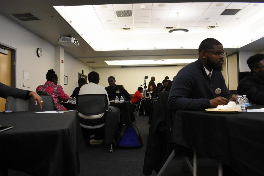 Students+talk+during+the+10th+annual+Black+Male+Summit.