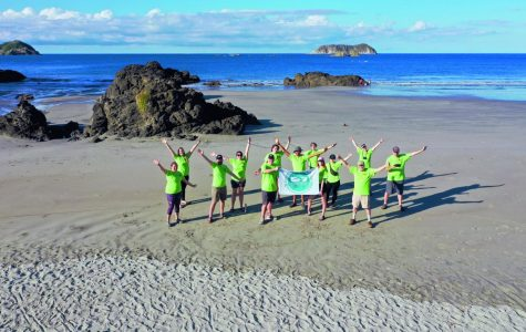 Dr. Benjamin Weibell's Fundamentals of Ecology Travel Study class celebrates on the beach in Costa Rica.