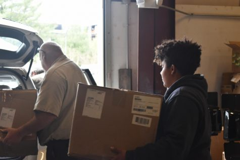 AACC maintenance staff loads boxes of medical supplies the college donated to local hospitals.