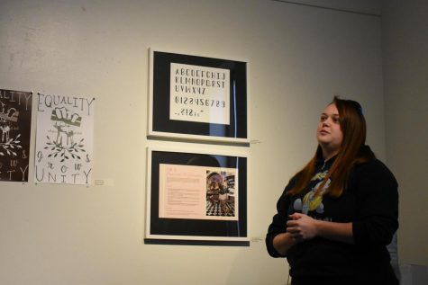 Second-year visual arts student Jess Gordon-Young explains her art to attendees at the Art of Women Invitational Exhibit.