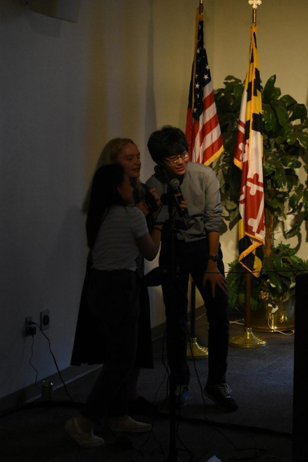 Ryan Kim (right) performs Karaoke with SGA members.