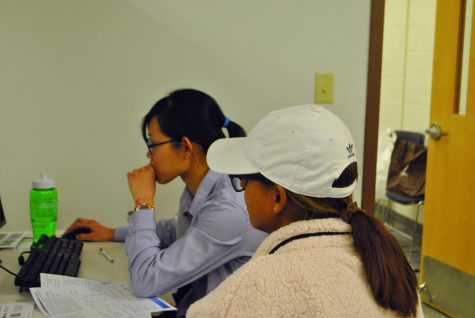 Second-year business administration student Yen Truong helps a member of the community with her taxes.