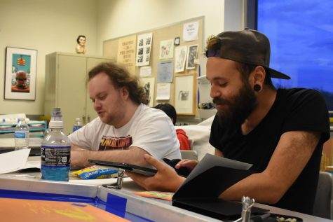 Art Association Vice President Vinni Quagliato (right) and second-year transfer studies student Zev Berman work on projects