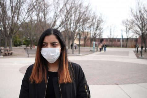 Lindsey Gonzalez, a third-year transfer studies student, wears a surgical on the quad to protect from the coronavirus.