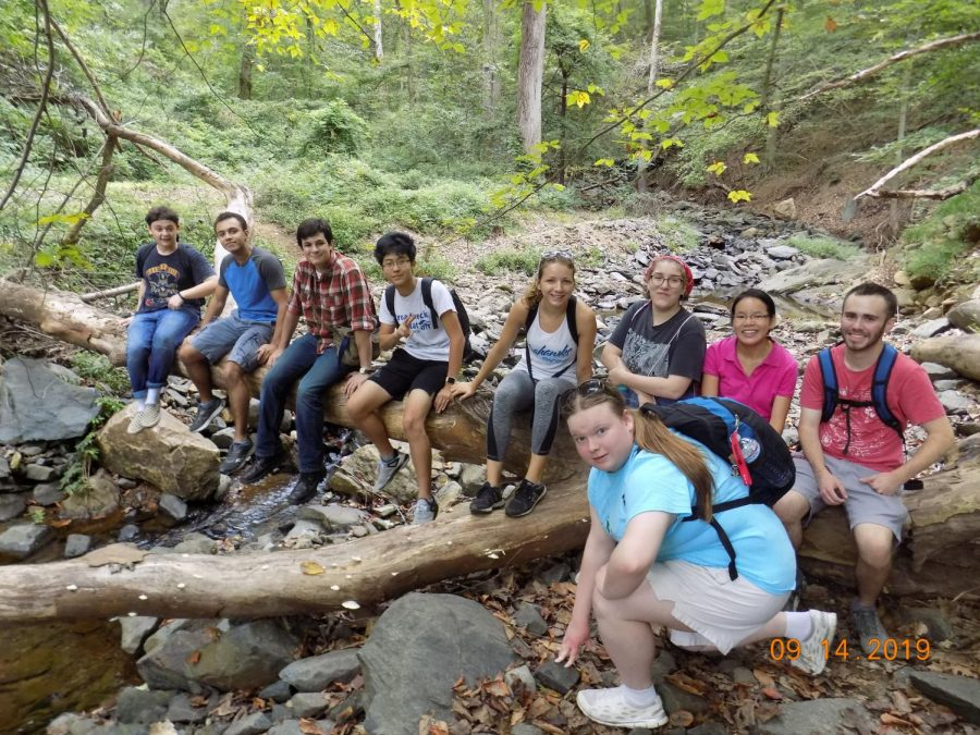 AACC Adventure Club members take a break from hiking the Patapsco Valley trail last fall. The club president plans to organize another hike this semester.