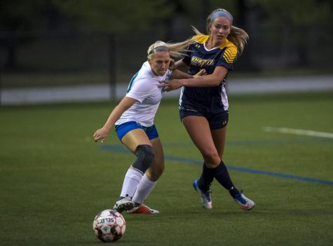 AACC Women's Soccer defender Morgan Duly, left, last fall, says she understands that canceling fall sports will keep college athletes safe.
