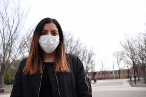 Lindsey Gonzalez, a third-year transfer studies student, wears a surgical mask on AACC's campus in 2020. Campus Current ran this photo with the first article it published about the coronavirus.