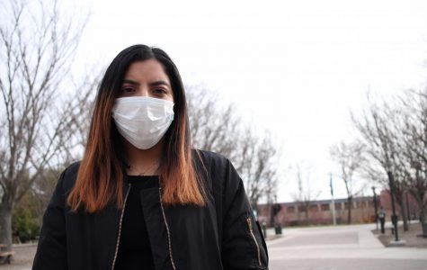 Lindsey Gonzalez, a third-year transfer studies student, wears a surgical mask on AACC's campus last semester