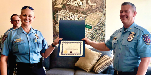 Sgt. Janene Kerpelman, left, is the first AACC police officer promoted to sergeant.